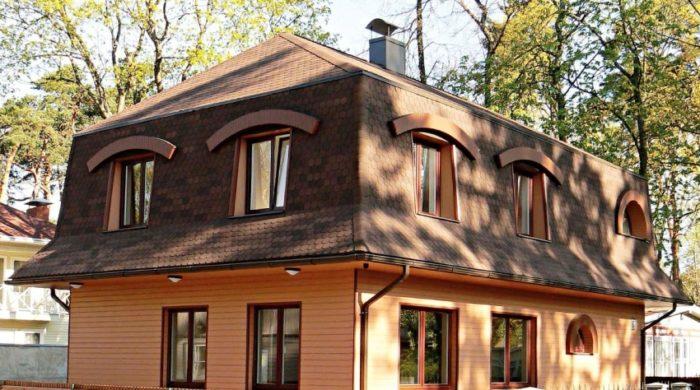 Пример удачной реализации мансардной крыши усложненной конструкции